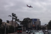 A flight path runs over Balboa Park